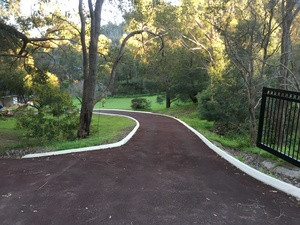 Rural driveway Bickley Perth Hills - red bitumen with kerbing