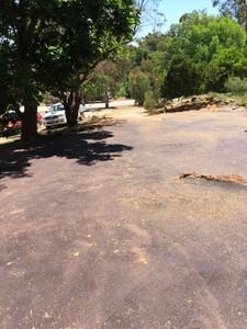 New red asphalt driveway