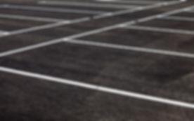White traffic markings on a gray asphalt