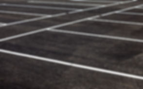 White traffic markings on a gray asphalt