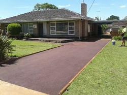 red asphalt driveway