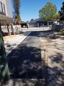 Black asphalt rear laneway