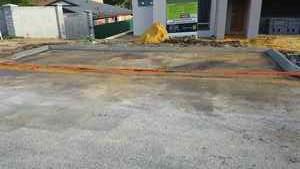 Visitor parking bay on verge - red asphalt