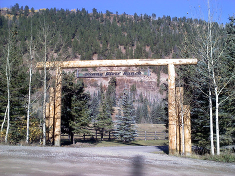 Triple Beam Lodge Pole Archway with Sign