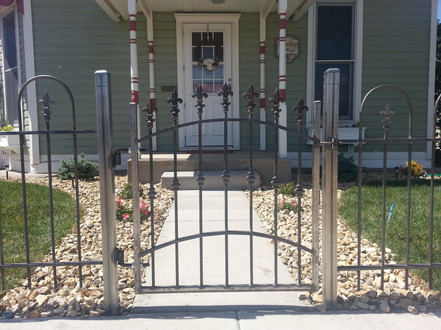 Arched Top Finial Gate with Rusty Hoop and Picket Fence