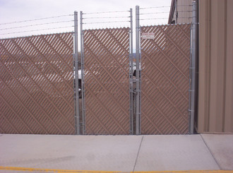 Industrial with Barbwire and Privacy Slats