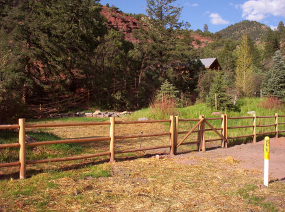 Round Rail Fence with Double Drive Gate