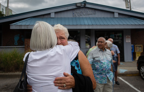 An emotional Betty Sue thanks her friend Tina at their 60th high school reunion gathering. Tina's husband reached out to John the night before at another gathering, which Betty Sue said meant a lot to her.