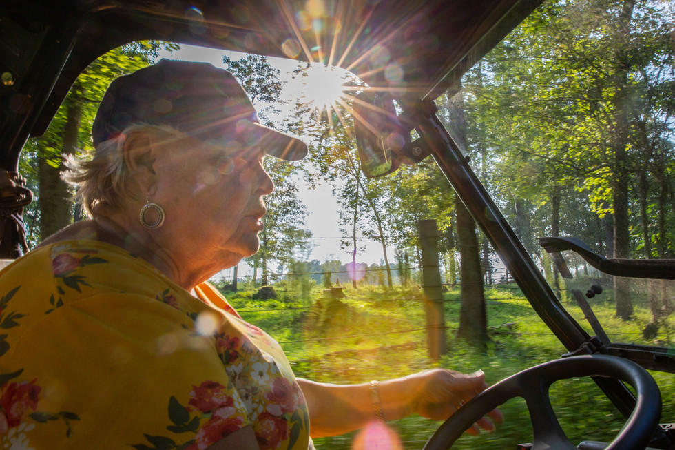 """Although Betty Sue and John's sons do much of the maintenance for the farm, Betty Sue still goes out every day in her """"gator"""" to check on the cows and make sure things are as they should be. """"Always something going on around here,"""" says Betty Sue."""
