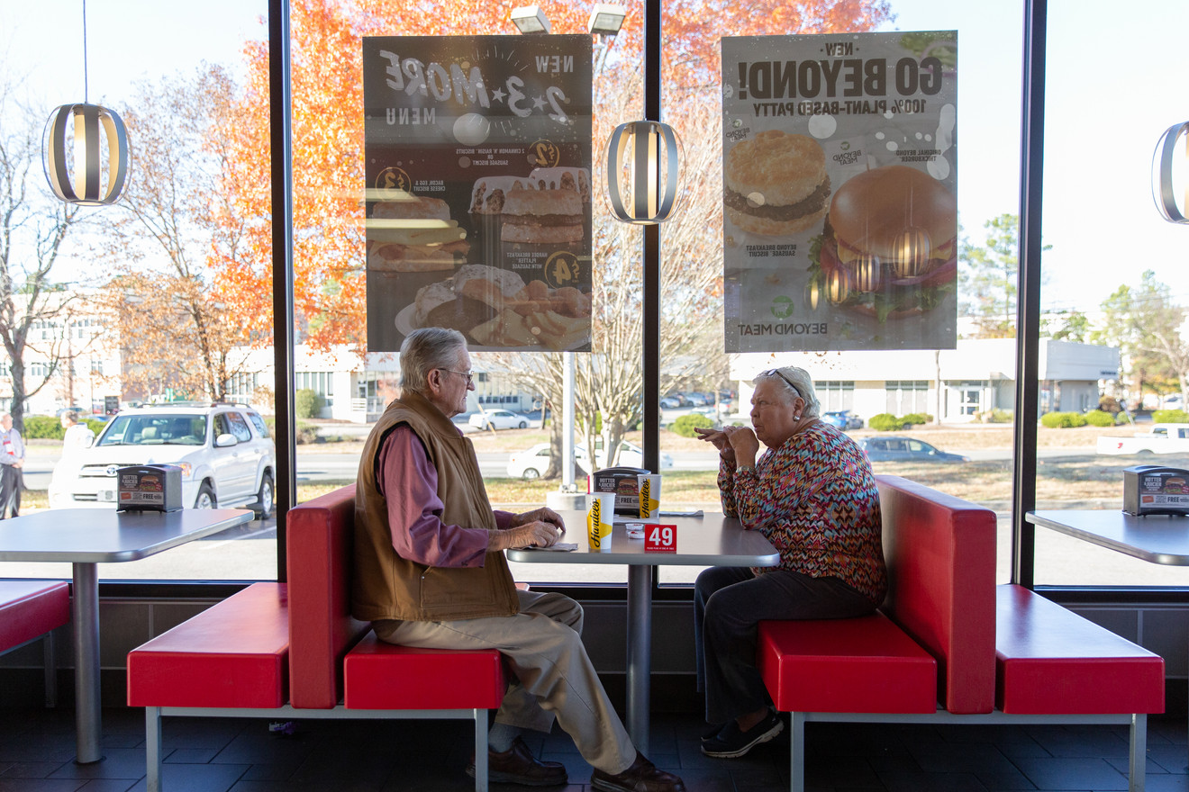 Betty Sue and John have lunch at Hardee's after John's doctor's appointment. John's doctor warned Betty Sue to check on John's food intake to make sure his body is healthy enough to undergo a procedure next month.