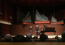 with violinist Max Tan at a recital in New York