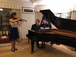 rehearsing with Eva Zavaro for recitals in England and Germany