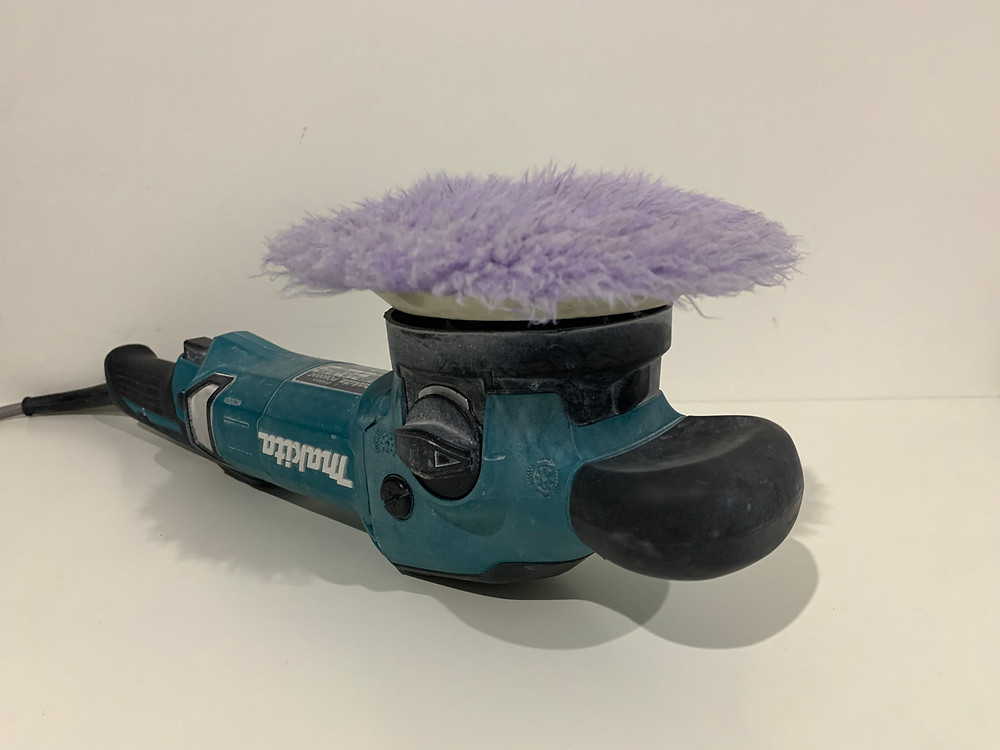 Makita PC6000C polisher with Lake Country purple foamed wool pad