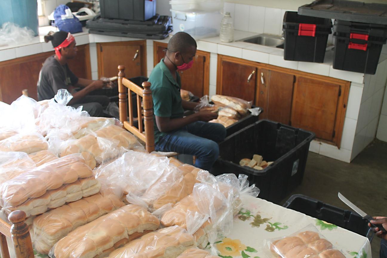 Breakfast program cutting bread for sandwich