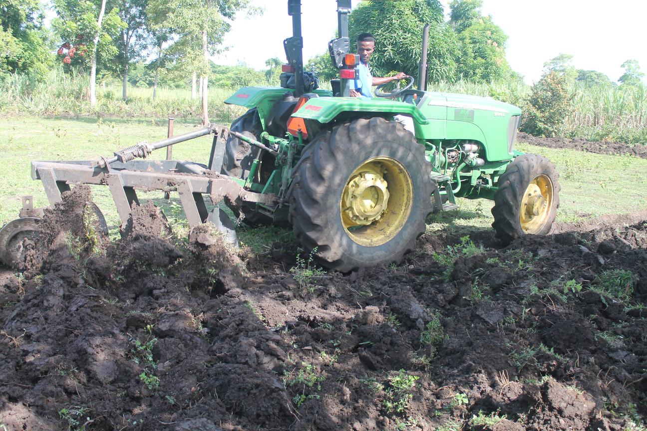 Plowing farmer's land