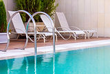 chairs by pool