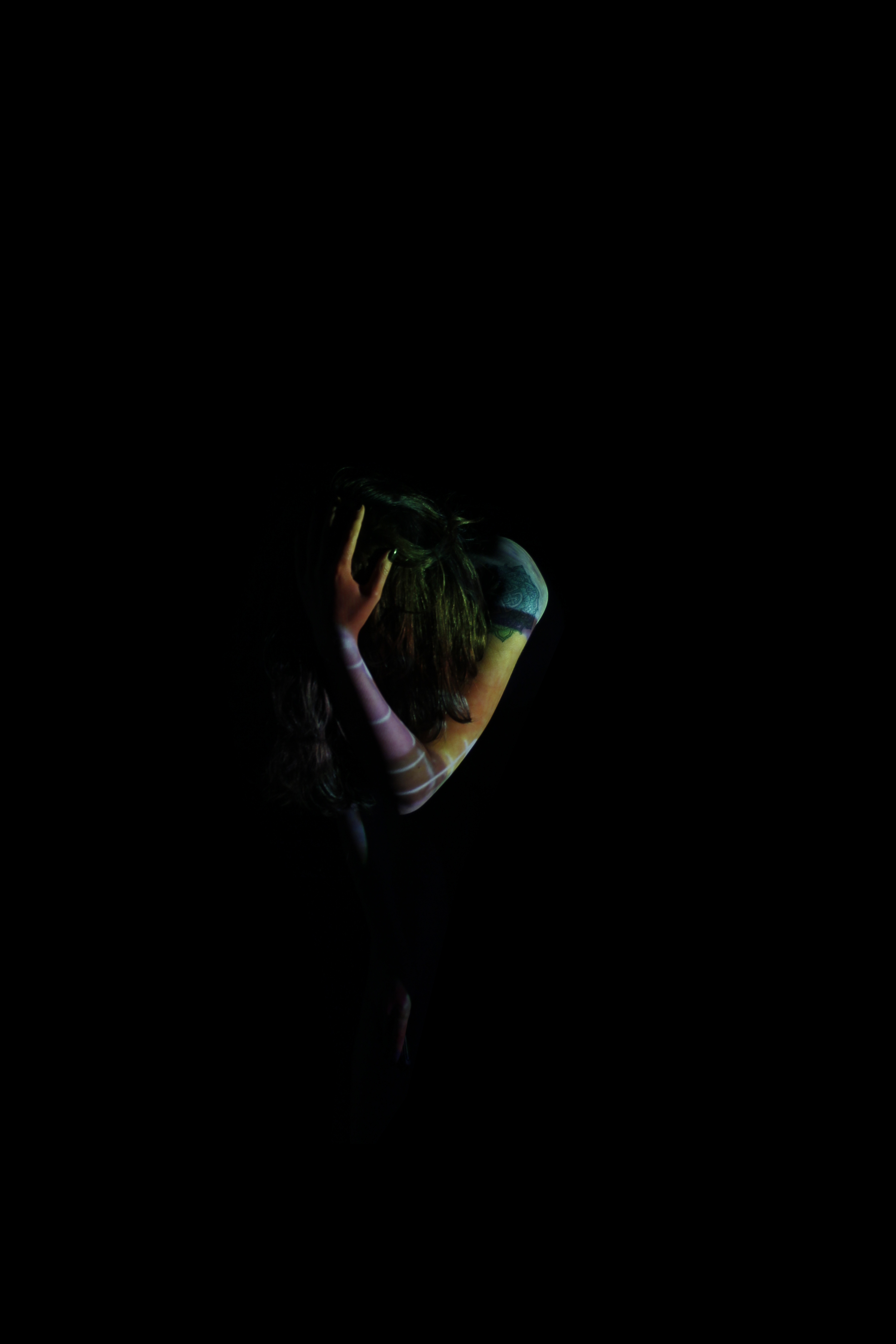 Photograph: Model with color on black background