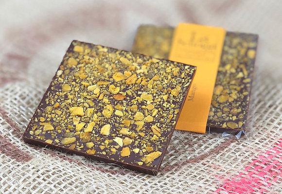 Mangomango – handgemachte Edelschokolade mit kleinen Stückchen gerocknete Mango