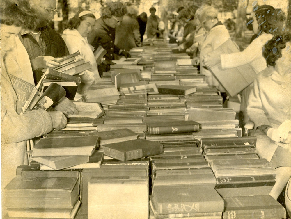 Patrons at the Friends of Crandall Library book sale c. 1965. Photographed by Carl Atiyeh. < CPL494, Crandall Library Photograph Collection, The Folklife Center at Crandall Public Library, Glens Falls, NY>