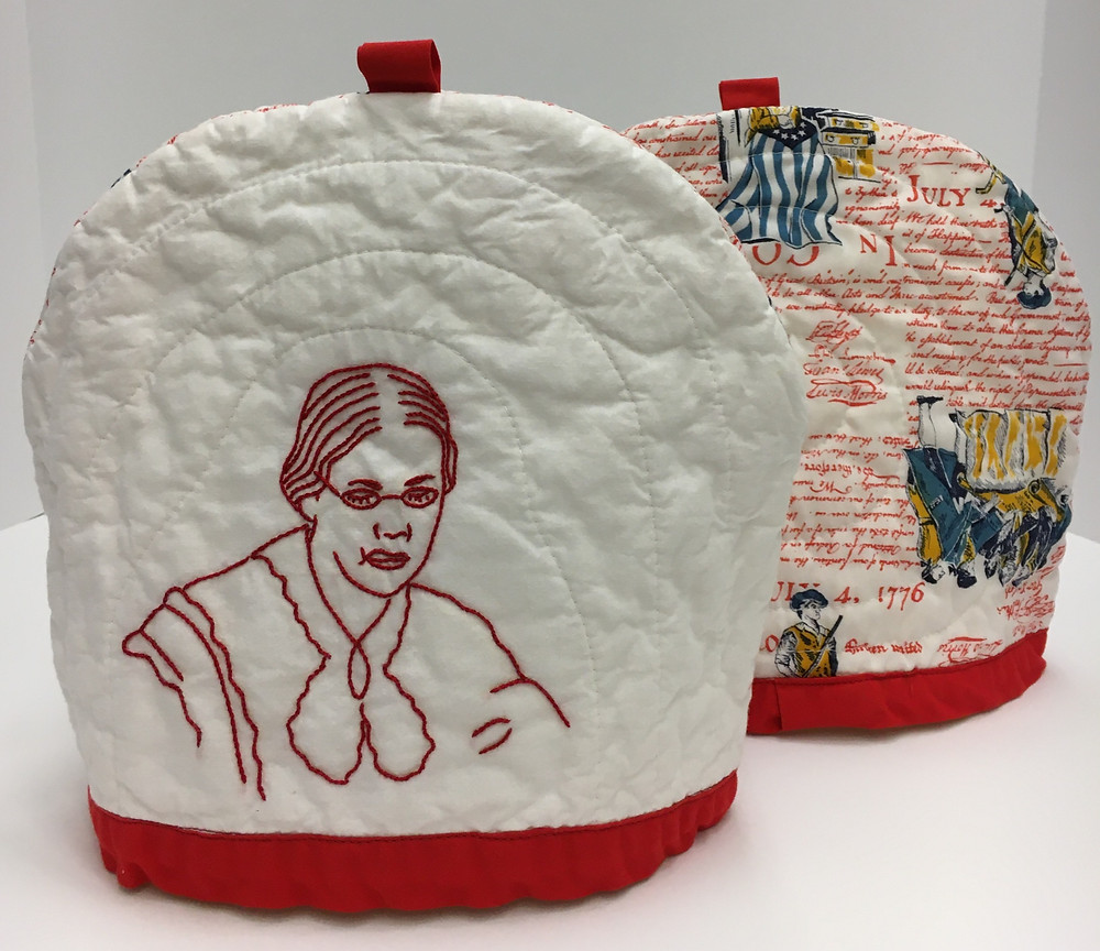 Hand embroidered portrait of Susan B. Anthony on machine quilted tea cozy. Online exhibition at https://www.crandalllibrary.org/folklife-center/folklife-gallery/