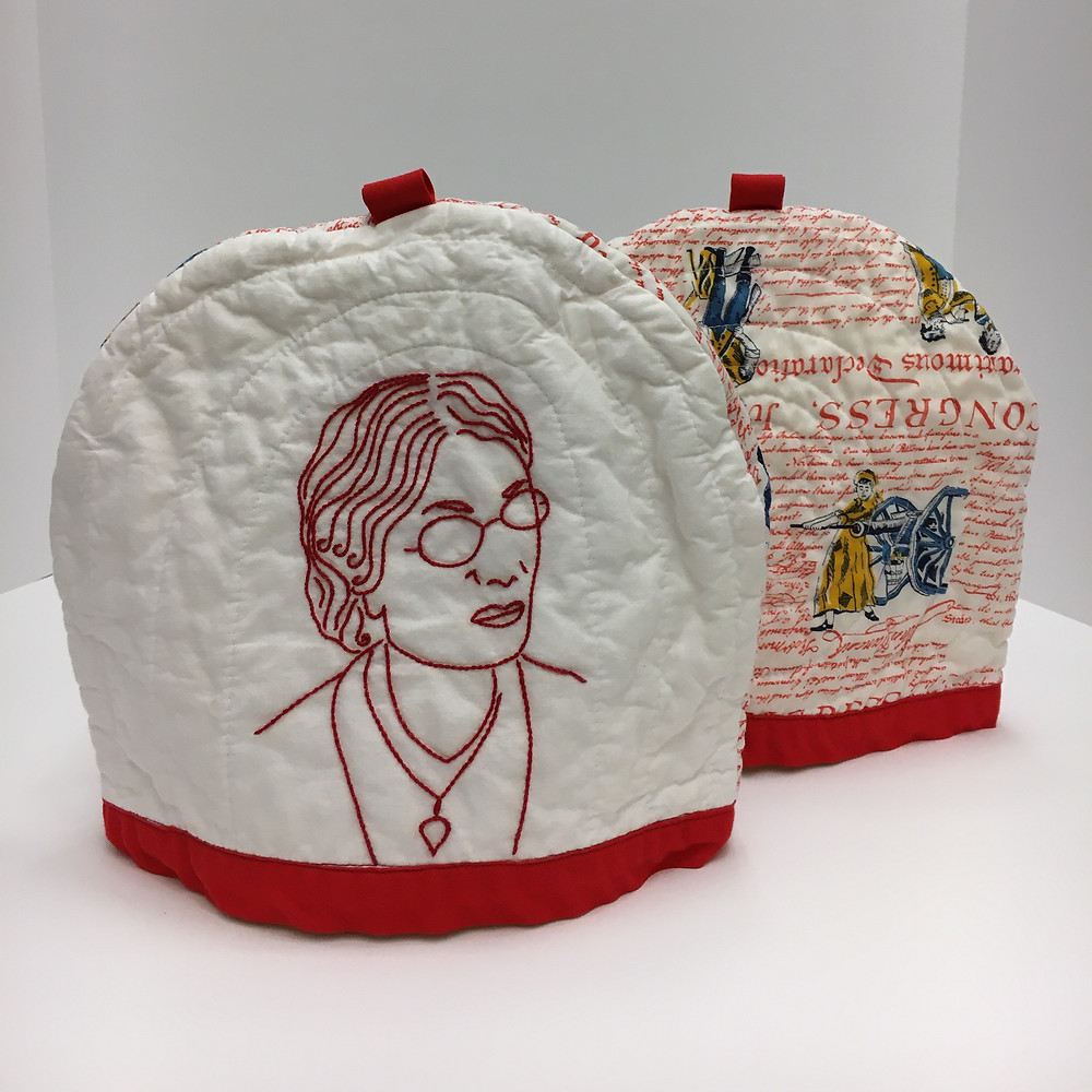 Dr. Annetta Barber, embroidered portrait tea cozy by Tisha Dolton, 2020. Part of the exhibit: Equali-tea: Suffragist Tea Cozies in Redwork A Suffrage Centennial exhibition at the Folklife Center at Crandall Public Library.
