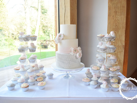 Stacking wedding cakes at the venue!