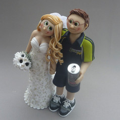 groom with beer can wedding cake topper