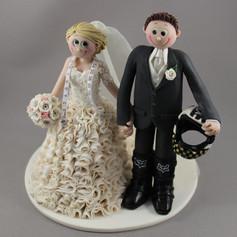 dressmaker and motorbike rider wedding cake topper