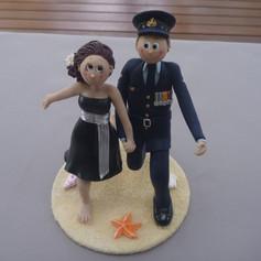 running on beach wedding cake topper, groom in military uniform
