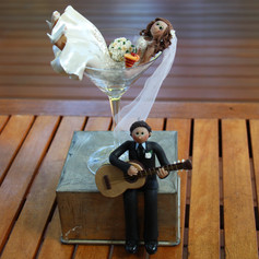 bride in cocktail glass, groom with guitar, custom made wedding cake topper