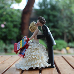 hiding shopping, kissing bride and groom cake topper