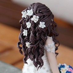 pretty hair with orchids, custom made wedding cake topper