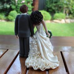 Back view of ruffle dress, custom made wedding cake topper