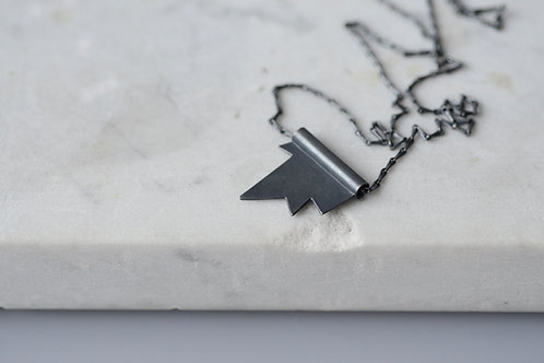 Oxidised sterling silver spark tubular pendant and barleycorn chain.