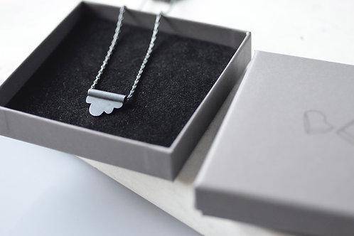Oxidised sterling silver cloud tubular pendant and barleycorn chain.