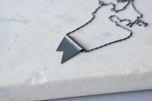 Oxidised sterling silver spark tubular pendant and barleycorn chain.