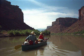 Canoe floating through canyon