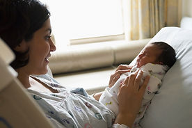 woman in hospital with newborn