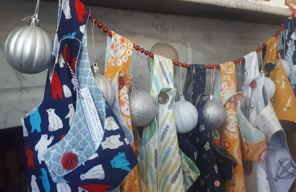 dresses hanging on the mantlepiece