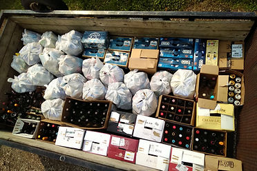 a trailer full of empty wine bottles and beer cans to raise money for animal rescues