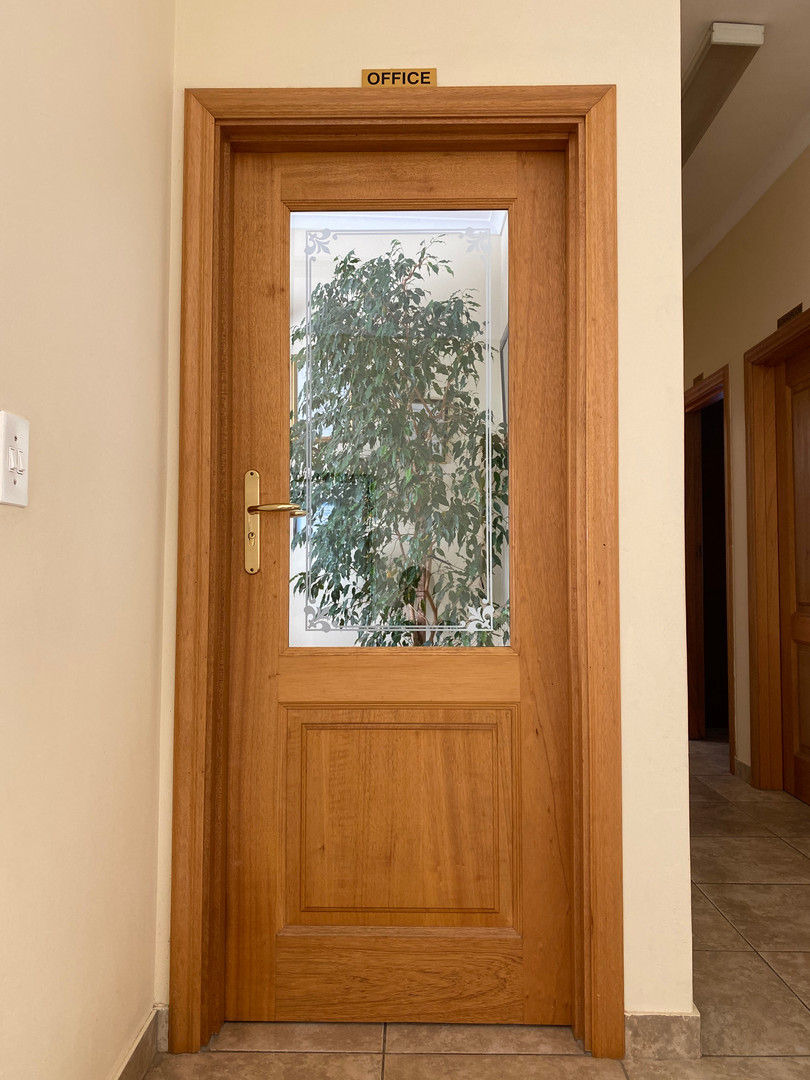 1 Panel Glass top door with architraves.