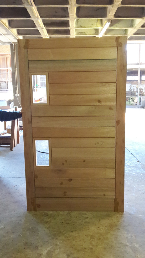 Horizontal slatted door with Two glass p