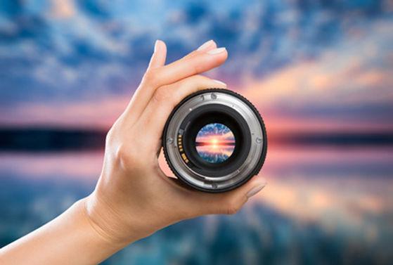 B2B-hand-holding-camera-lens.jpg