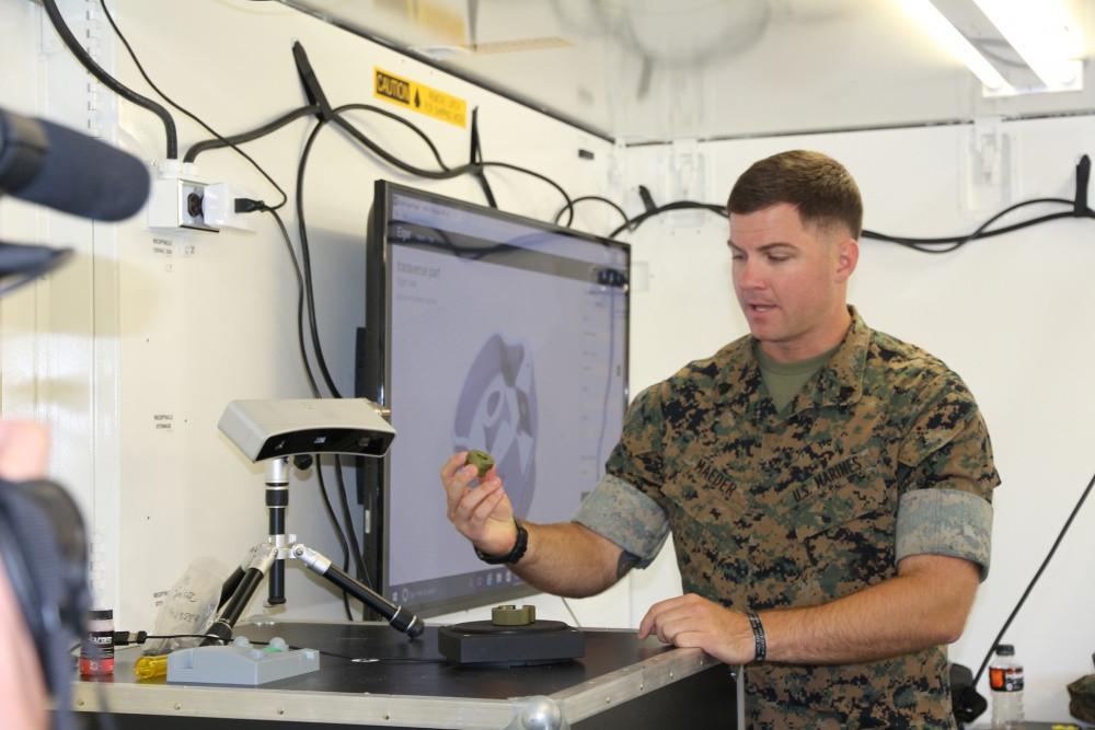 Sgt. Ethan Maeder demos a 3D scanner in the X-FAB. U.S. Marine Corps photo by Kailtin Kelly
