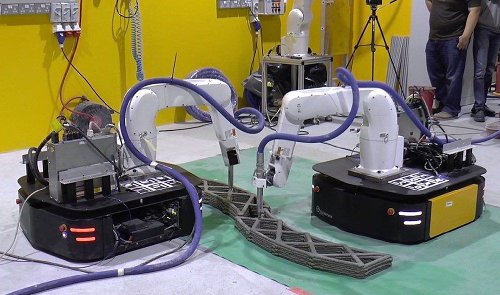 A team of robot arms on mobile bases can 3D print large structures quickly
