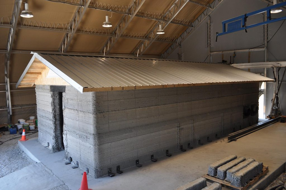 Cement barracks hut 3D printed at the Construction Engineering Research Laboratory in Champaign, Illinois. Army photo by Mike Jazdyk