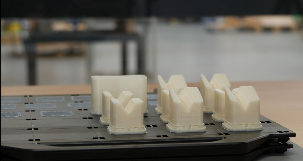 Fixtures produced on the Stratasys 3D printers. Photo via SYS Systems.