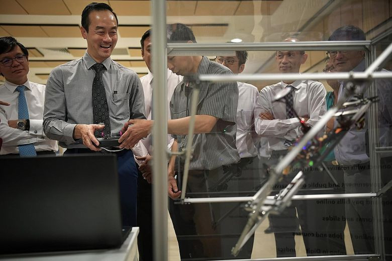 Senior Minister of State for Trade and Industry Koh Poh Koon trying out a drone demonstration unit yesterday at the inaugural Aerospace Engineering Week at ITE College Central, where he also launched the Worker 4.0 Digital Readiness Certificate. The