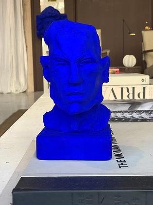 Miniature clay-cast plaster head in blue