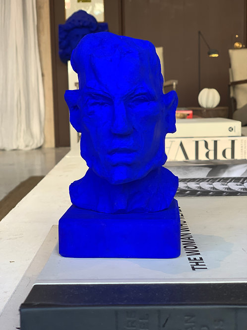 Miniature clay-cast plaster head in blue